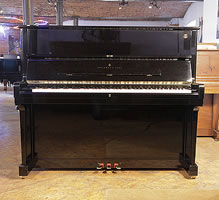 A 1998, Steinway Model V upright piano with a black case and brass fittings