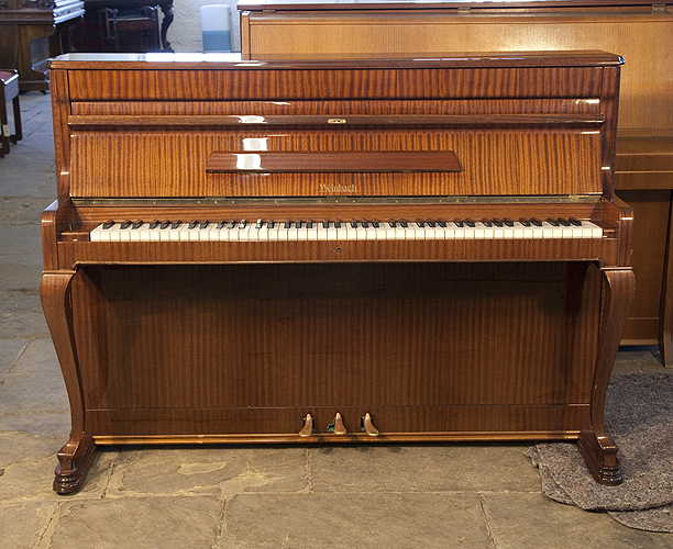 A Weinbach upright piano with a mahogany case and cabriole legs