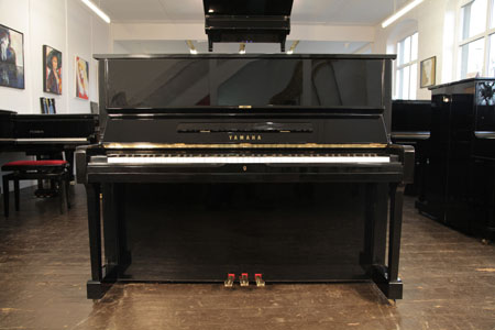 A reconditioned,  1998, Yamaha U1 upright piano with a black case and polyester finish