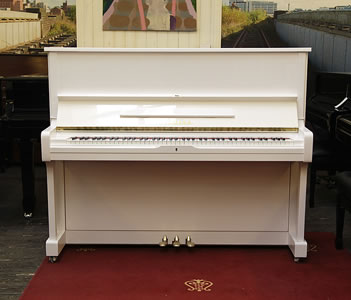 A reconditioned,  1986, Yamaha U1A upright piano with a white case and polyester