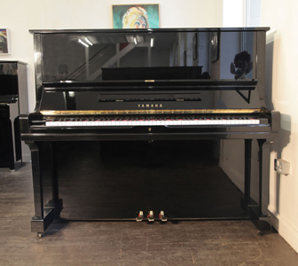 A reconditioned,  1972, Yamaha U3 upright piano with a black case and polyester