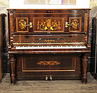 Piano for sale. Rebuilt, Ascherberg upright piano for sale with a rosewood case and baluster legs. Cabinet inlaid with Neoclassical design featuring flowers, urns, musical instruments, figures, shells and scrolling acanthus.