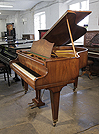 Piano for sale. Pre-owned, 1937, Bechstein Model S baby grand piano with a satin, figured walnut case and tapered legs