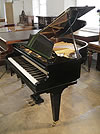 Piano for sale. Pre-owned, Bechstein Model S grand piano with a black case and tapered legs