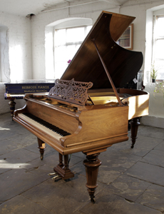 An 1900, Bechstein Model V grand piano for sale with a walnut case and turned legs