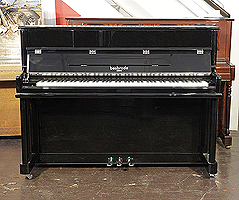 A brand new, Besbrode SU112 upright piano with a black case and chrome fittings