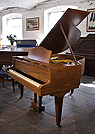 Piano for sale.  A 1936, Bluthner baby grand piano for sale with a walnut case and square, tapered legs