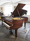 Piano for sale.   A 1923, Bluthner grand piano for sale with a rosewood case, openwork music desk and square, tapered legs