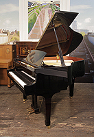 A  Boston GP156 baby grand piano for sale with a black case and spade legs.