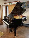 Piano for sale. A 2000, Boston GP178 PE grand piano for sale with a black case and spade legs