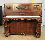 Piano for sale. Antique, Ernst Irmler upright piano for sale with an ornately carved, rosewood case, Cabinet features carved panels of winged females with scrolling foliage and reverse scroll legs with carved femal heads