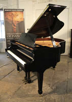A pre-owned, Essex EGP155 baby grand piano with a black case and polyester finish