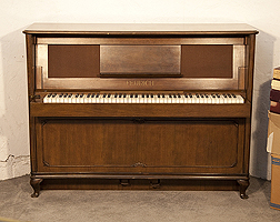 Artcased, 1937, Feurich ship upright piano with a walnut case, folding keyboard and wickerwork front panel