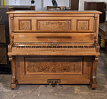 Piano for sale. A 1908, Feurich upright piano with a walnut case, burr walnut panels and an unusual walnut keyboard Piano has an eighty-five note keyboard and two pedals