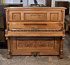 Piano for sale. A 1908, Feurich upright piano with a walnut case, burr walnut panels and an unusual walnut keyboard