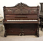 Piano for sale. Rococo style, Francke upright piano for sale with an ornately carved, mahogany case and reverse scroll legs