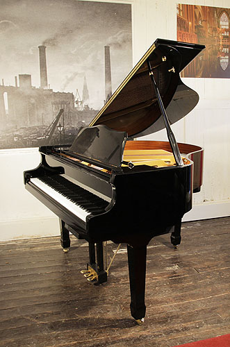 A pre-owned, Hamlyn Klein CJS-142 baby grand piano for sale with a black case and spade legs. Piano has a fitted PianoDIsc PianoCD player system