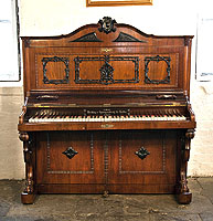 A Holling Spangenberg upright piano for sale with a rosewood case, candlestick holders and claw foot legs