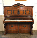 Piano for sale. A Holling Spangenberg upright piano for sale with a rosewood case, candlestick holders and claw foot legs.