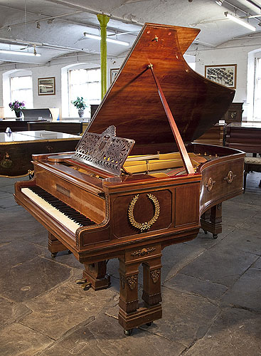 Empire style, 1901, Ibach model 2 grand piano for sale with a mahogany case and gate legs. Entire cabinet decorated with ormolu mounts featuring scenes of greek gods and goddesses and wreaths.