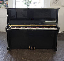 A 1987, Kawai BS-30 upright piano with a black case and polyester finish.