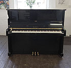 Piano for sale. A 1987, Kawai BS-30 upright piano with a black case and polyester finish.