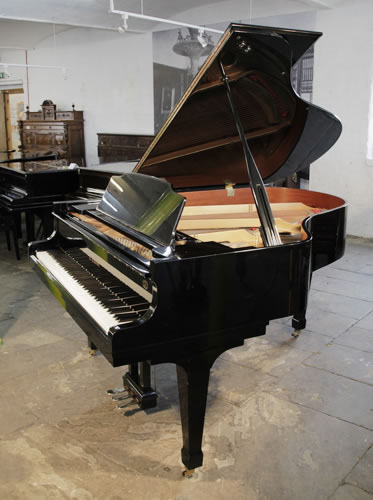 Piano for sale. A 1987, Kawai CA-40M grand piano for sale with a black case and spade legs. A 60th Anniversary Limited Edition model