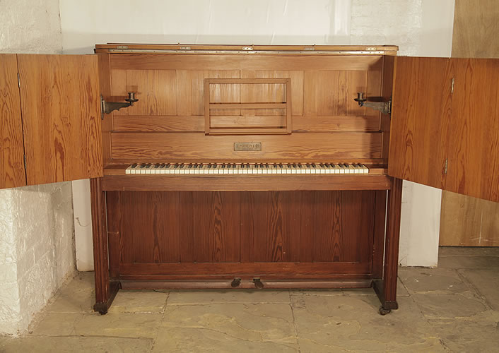 Mayer upright piano for sale with an Arts and Crafts style cabinet with carved panels and decorative hinges and candlesticks