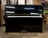 Piano for sale.  Karl Muller SR-2 Upright Piano For Sale with a Black Case and Brass Fittings