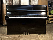 Piano for sale.  Karl Muller Upright Piano For Sale with a Black Case and Brass Fittings