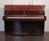 Piano for sale. A Neumayer upright piano with a mahogany case. Piano has an eighty-eight note keyboard and three pedals.