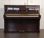Piano for sale. A Richmann upright piano with a mahogany case. Piano has an eighty-eight note keyboard and three pedals.