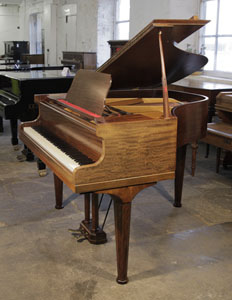 A  1933, Rogers Baby Grand Piano For Sale with a Mahogany Case and Octagonal, Faceted Legs. Piano has two Sheet Music Storage Drawers