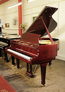 Royale DG-1 baby grand piano with a mahogany case and polyester finish.