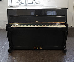 A Sauter S110 Upright Piano For Sale with a Black Case and Cabriole Legs
