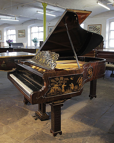 An 1899, Chinese Chippendale style, Schiedmayer grand piano for sale with a flame mahogany case and Malborough legs. Cabinet features Chinese scenes in embossed Japanning.