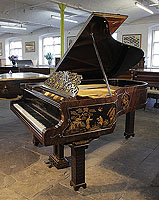 An 1899, Chinese Chippendale style, Schiedmayer grand piano for sale with a flame mahogany case and Malborough legs with applied fret carvings. Cabinet features Chinese scenes in embossed Japanning with gilt ornament.