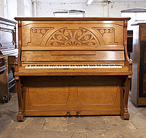 Seiler upright piano for sale with an Art Nouveau style walnut case. Cabinet features a front panel carved with stylised poppies