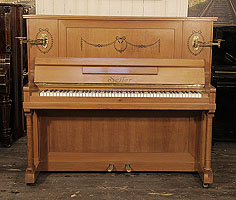 Artcased, 1911, Seiler upright piano for sale with a walnut case and two turned, column legs. Cabinet inlaid with contrasting ebony with stylised flowers, swags and bows