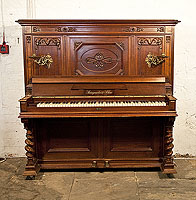 Steingraeber upright piano with a Neoclassical style, carved mahogany case and barley twist legs.