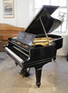 Piano for sale. A 1914, Steinway Model A grand piano with an ebonised case and spade legs. Music desk features an elegant, geometric cut-out design.