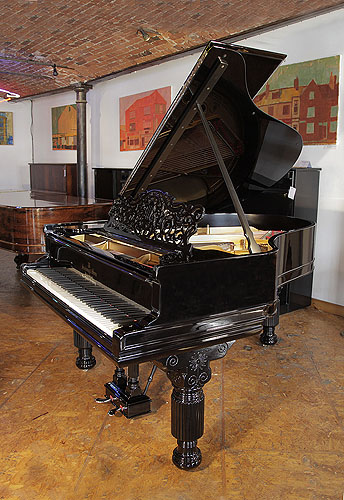 An 1884, Steinway Model A grand piano for sale with a black case, filigree music desk and fluted, barrel legs