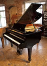 Piano for sale. A 2003, Steinway Model A grand piano with a black case and spade legs. Eighty-eight note keyboard and a three-pedal lyre.