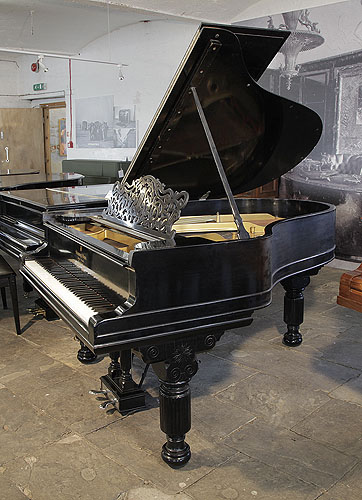 An 1886, Steinway Model A grand piano for sale with a black case, filigree music desk and fluted, barrel legs