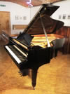 Piano for sale. A 1974, Steinway Model B grand piano with a black case and spade legs. Piano has a three-pedal lyre and an eighty-eight note keyboard.