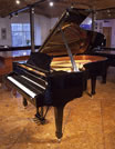 Piano for sale. A 2013, Steinway Model B grand piano for sale with a black case and spade legs