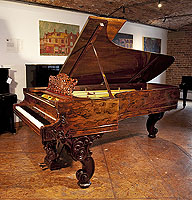 A stunning, 1877, Steinway & Sons Model D concert grand piano with an exquisite wood case and reverse scroll legs.