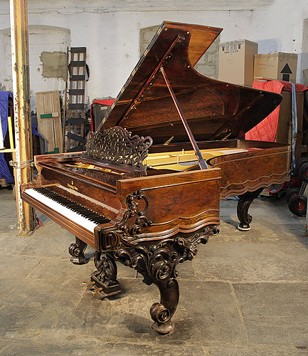 An 1874, Steinway Model D Concert Grand piano for sale with a rosewood case, filigree music desk and ornately carved, reverse scroll legs