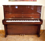 A 1985, Steinway Model K upright piano with a mahogany case and brass fittings