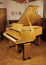 Piano for sale. Art-Deco style, restored, 1932, Steinway Model M grand piano for sale with a crossbanded, maple and coromandel case. Cabinet features strong geometric styling